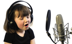 Little Girl Recording with microphone and pop filter
