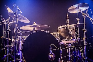 Drumkit on empty stage waiting for musicians (logo removed)