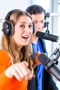 Woman and Man Podcasting